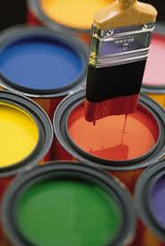 Paint brush and paint pots.